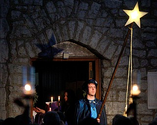 A star is illuminated in the church during the Boar's Head and Yule Log Festival at St. John's Episcopal Church on Sunday afternoon. EMILY MATTHEWS | THE VINDICATOR