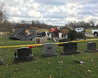 .HereÕs What is left of the cemetery storage building at hillside cemetery after Highwinds or a tornado blew through this morning. kris parke the bazettaa Township Road superintendent said he believes about 50 trees were also knocked over in the cemetery..