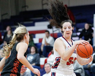 Fitch's Sabria Hunter dribbles the ball while Howland's Alex Ochman comes up to try to block her during the first half of their game at Fitch High School on Wednesday night. EMILY MATTHEWS | THE VINDICATOR