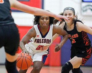 Fitch's Jada Lazaro dribbles the ball while Howland's Ashley Chambers, right, and Jenna Craigo, left, try to block her during the first half of their game at Fitch High School on Wednesday night. EMILY MATTHEWS | THE VINDICATOR