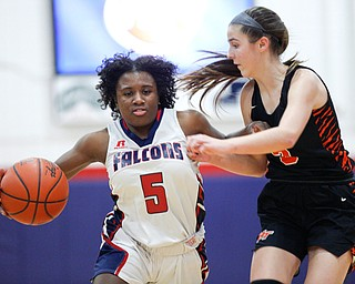 Fitch's Jada Lazaro dribbles the ball while Howland's Ashley Chambers tries to block her during the first half of their game at Fitch High School on Wednesday night. EMILY MATTHEWS | THE VINDICATOR