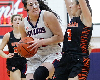 Fitch's Sabria Hunter advances toward the hoop while Howland's Ashley Chambers tries to block her during the first half of their game at Fitch High School on Wednesday night. EMILY MATTHEWS | THE VINDICATOR
