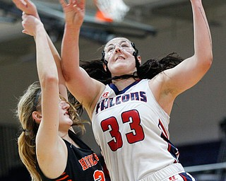 Fitch's Sabria Hunter goes for a basket while Howland's Alex Ochman tries to block her during the first half of their game at Fitch High School on Wednesday night. EMILY MATTHEWS | THE VINDICATOR