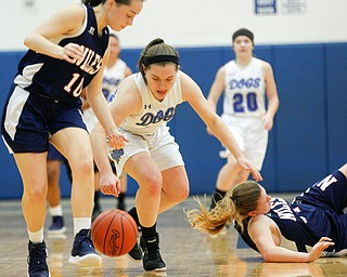 Poland's Kat Partika and Niles' Brandi Baker, left, go after the ball after Niles' Lindsay Hayes, right, falls during their game at Poland on Thursday. EMILY MATTHEWS | THE VINDICATOR