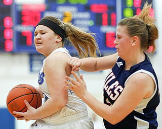 Poland's Mia Gajdos goes towards the hoop while Niles' Lindsay Hayes tries to block her during their game at Poland on Thursday. EMILY MATTHEWS | THE VINDICATOR