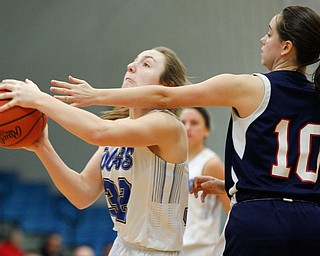 Poland's Morgan Kluchar looks towards the hoop while Niles' Brandi Baker tries to block her during their game at Poland on Thursday. EMILY MATTHEWS | THE VINDICATOR
