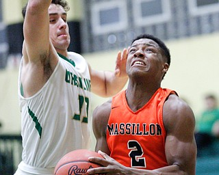 Massillon's Kyshad Mack looks towards the net while Ursuline's Luke Pipala tries to block him during their game at Ursuline on Friday night. EMILY MATTHEWS | THE VINDICATOR