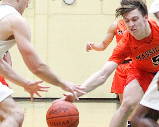 Massillon's Anthony Pedro and Ursuline's Luke Pipala go after the ball during their game at Ursuline on Friday night. EMILY MATTHEWS | THE VINDICATOR
