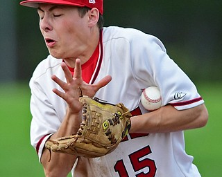 STRUTHERS, OHIO - MAY 15, 2018: Niles' Luke Swauger fields the ball before throwing it to first for the final out in the seventh inning to defeat Poland on Tuesday afternoon at Cene Park. Niles won 4-3. DAVID DERMER | THE VINDICATOR