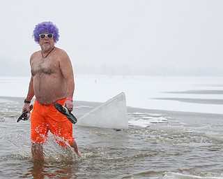 Mike Montler, who was with the group Livin' for Livi, participates in the Annual Polar Plunge in Mosquito Lake in Cortland on Saturday. EMILY MATTHEWS   THE VINDICATOR