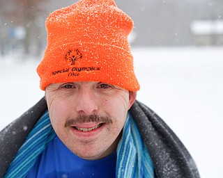 Craig Myers a special olympian from Tampa, Florida, poses for a portrait after participating in the Annual Polar Plunge in Mosquito Lake in Cortland on Saturday. EMILY MATTHEWS   THE VINDICATOR