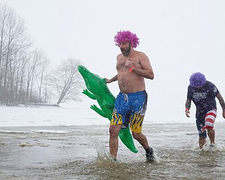 Dan Goddard, of Champion, left, and Mike Watson, of Niles, right, both with the group Livin' for Livi, participate in the Annual Polar Plunge in Mosquito Lake in Cortland on Saturday. The group was created after Watson's daughter Livi passed away after getting hit by a drunk driver. EMILY MATTHEWS   THE VINDICATOR