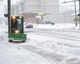 Michael Depizzo, of Liberty and with Depco Inc., plows a sidewalk on West Rayen Avenue on Saturday afternoon. EMILY MATTHEWS   THE VINDICATOR