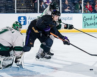 Scott R. Galvin   The Vindicator.Youngstown Phantoms forward Trevor Kuntar (16) reaches for the puck against Cedar Rapids RoughRiders defenseman Mitchell Miller (28) during the first period at the Covelli Centre on Saturday, January 19, 2019.  The Phantoms lost 4-2.