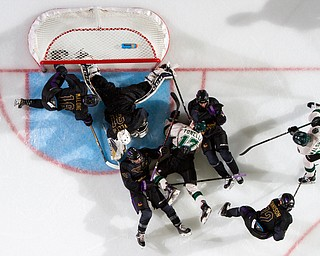 Scott R. Galvin   The Vindicator.Youngstown Phantoms goalie Chad Veltri (31) makes a save as players from the Phantoms and Cedar Rapids RoughRiders fall around him in front of the net during the second period at the Covelli Centre on Saturday, January 19, 2019.  The Phantoms lost 4-2.