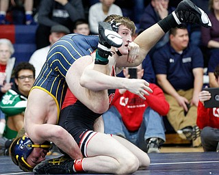 Canfield's David Reinhart, right, and Tallmadge's Richie Eyre wrestle during the final round of the Josh Hephner Memorial Wrestling Tournament at Austintown Fitch High School on Saturday. Reinhart was the champion in the 160 weight class. EMILY MATTHEWS | THE VINDICATOR