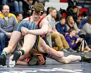 Canfield's David Reinhart, back, and Tallmadge's Richie Eyre wrestle during the final round of the Josh Hephner Memorial Wrestling Tournament at Austintown Fitch High School on Saturday. Reinhart was the champion in the 160 weight class. EMILY MATTHEWS | THE VINDICATOR
