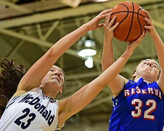 McDONALD, OHIO - JANUARY 28, 2019: Western Reserve's Alyssa Serensky, right, and McDonald's Sophia Costantino reach for a rebound during the second half of their game, Monday night at McDonald High School. McDonald won 56-55 in overtime. DAVID DERMER | THE VINDICATOR