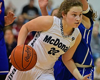 McDONALD, OHIO - JANUARY 28, 2019: McDonald's Molly Howard drives on Western Reserve's Brooke Morris during the second half of their game, Monday night at McDonald High School. McDonald won 56-55 in overtime. DAVID DERMER | THE VINDICATOR