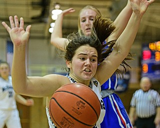 McDONALD, OHIO - JANUARY 28, 2019: McDonald's Taylor Tuchek loses control of the ball after colliding with Western Reserve's Olivia Pater during the second half of their game, Monday night at McDonald High School. McDonald won 56-55 in overtime. DAVID DERMER | THE VINDICATOR