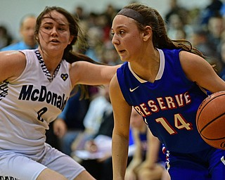 McDONALD, OHIO - JANUARY 28, 2019: Western Reserve's Kennedy Miller drives on McDonald's Taylor Tuchek during the second half of their game, Monday night at McDonald High School. McDonald won 56-55 in overtime. DAVID DERMER | THE VINDICATOR