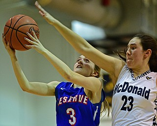 McDONALD, OHIO - JANUARY 28, 2019: Western Reserve's Maddy Owen goes to the basket against McDonald's Sophia Costantino during the second half of their game, Monday night at McDonald High School. McDonald won 56-55 in overtime. DAVID DERMER | THE VINDICATOR