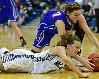 McDONALD, OHIO - JANUARY 28, 2019: McDonald's Olivia Perry and Western Reserve's Danielle Vuletich battle for a loose ball during the second half of their game, Monday night at McDonald High School. McDonald won 56-55 in overtime. DAVID DERMER | THE VINDICATOR