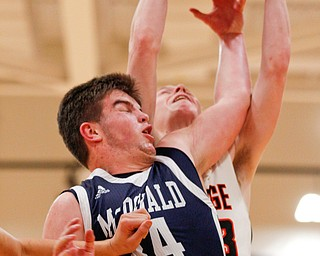 McDonald's Jake Portolese and Mineral Ridge's Jordan Zupko reach for a rebound during their game at Mineral Ridge on Tuesday night. EMILY MATTHEWS | THE VINDICATOR
