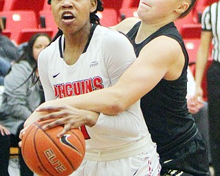 William D. Lewis The Vindicator YSU's Amara Chikwe(1) keeps the ball from Oakland's Chloe Guingrich(34) during 1-31-19 action at YSU.