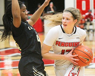 William D. Lewis The Vindicator YSU's Chelsea Olson(12) drives around Oakland's Brianna Breedy(24) during 1-31-19 action at YSU.