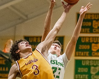 DIANNA OATRIDGE | THE VINDICATOR Cardinal Mooney's Sonny Rodriguez (3) and Ursuline's Johnny Rowland (23) reach for a rebound during Friday's  game at Ursuline High School.