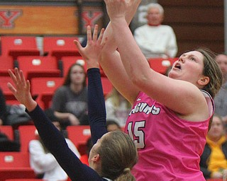 William D. Lewis The Vindicator YSU's Mary Dunn(15) shoots over Detroits Jess Bicknell(13) during 2-2-19 action at YSU.