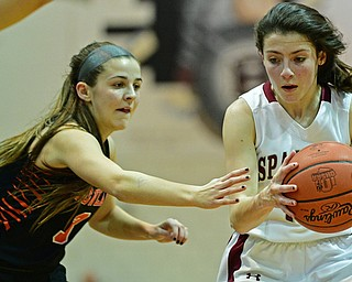 BOARDMAN, OHIO - FEBRUARY 4, 2019: Boardman's Raegan Burkey drives on Howland's Ashley Chambers during the first half of their game, Monday night at Boardman High School. DAVID DERMER | THE VINDICATOR