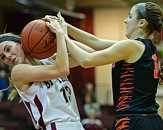BOARDMAN, OHIO - FEBRUARY 4, 2019:  Boardman's Cate Green fights with Howland's Ashley Chambers for the loose ball during the first half of their game, Monday night at Boardman High School. DAVID DERMER | THE VINDICATOR