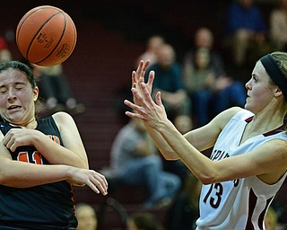 BOARDMAN, OHIO - FEBRUARY 4, 2019: Boardman's Cate Green loses control of the ball while Howland's Alyssa Pompelia protects herself during the first half of their game, Monday night at Boardman High School. DAVID DERMER | THE VINDICATOR