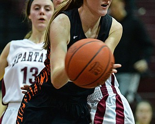 BOARDMAN, OHIO - FEBRUARY 4, 2019: Howland's Alex Ochman drives on Boardman's Katie Stamp during the second half of their game, Monday night at Boardman High School. DAVID DERMER | THE VINDICATOR