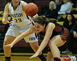 BOARDMAN, OHIO - FEBRUARY 4, 2019: Boardman's Maria Torres reaches for the loose ball as Howland's Alyssa Pompelia falls to the floor during the second half of their game, Monday night at Boardman High School. DAVID DERMER | THE VINDICATOR