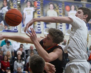 William D. Lewis The vindicator Lowellvilles Jack Rotz(15) swats the ball from Sprinfield's Clay Medvec(10)shoots past Springfields Evan Ohlin(1) during 2-5-19 action in Lowellville.
