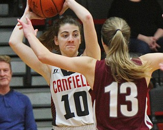 William D. Lewis The Vindicator  Canfield's Gianna Flask(10) passes around Boardman's Kate Green(13).