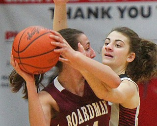 William D. Lewis The Vindicator Boardman's Emma Tokarsky(14) drives around Canfield's Gianna Flask(10).