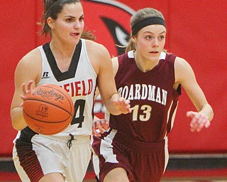 William D. Lewis The Vindicator Boardman's Canfield's Serena Sammarone(54) drives around Boardman's Kate Green(13).