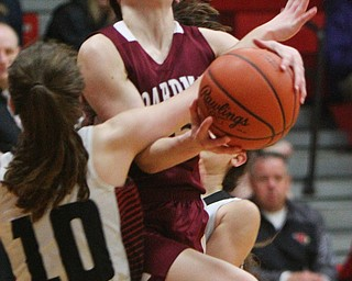 William D. Lewis The Vindicator Boardman's Raegan Burkey(15) collides with Canfield's Gianna Flask(10) .