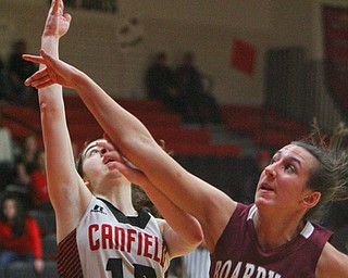 William D. Lewis The Vindicator Boardman's Emma Tokarsky(14) tries to block a shot from Canfield's Gianna Flask(10).