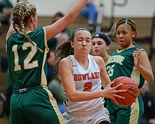 HOWLAND, OHIO - FEBRUARY 6, 2019: Howland's Maria Dellimuti drives on Lakeside's Makenna Condon during the first half of their game, Wednesday night at Howland High School. Howland won 89-40. DAVID DERMER | THE VINDICATOR