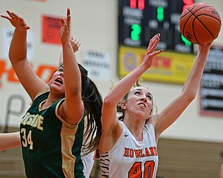 HOWLAND, OHIO - FEBRUARY 6, 2019: Howland's Kayla Clark grabs a rebound away from Lakeside's Hailee Aguinaga during the first half of their game, Wednesday night at Howland High School. Howland won 89-40. DAVID DERMER | THE VINDICATOR