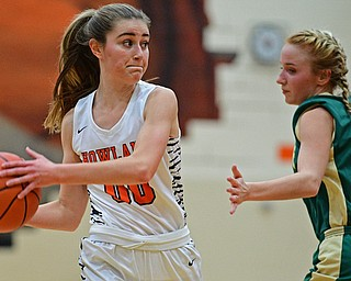 HOWLAND, OHIO - FEBRUARY 6, 2019: Howland's Jenna Craigo looks to pass while being pressured by Lakeside's Makenna Condon during the first half of their game, Wednesday night at Howland High School. Howland won 89-40. DAVID DERMER | THE VINDICATOR