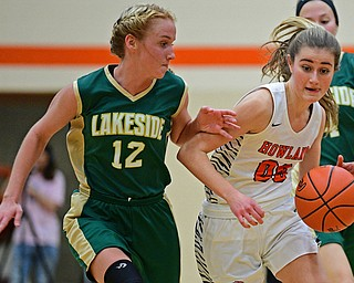 HOWLAND, OHIO - FEBRUARY 6, 2019:Howland's Jenna Craigo drives on Lakeside's Makenna Condon during the second half of their game, Wednesday night at Howland High School. Howland won 89-40. DAVID DERMER | THE VINDICATOR