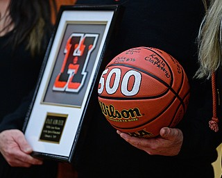 HOWLAND, OHIO - FEBURARY 6, 2019:Howland head coach John Diehl holds a basketball and plaque given to him to celebrate his 500th career win after Howland defeated Lakeside 89-40, Wednesday night at Howland High School. DAVID DERMER | THE VINDICATOR