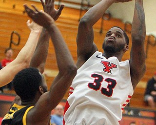 William D. Lewis The Vindicator YSU's Naz Bohannon(33) shoots over Milwaukee's DeAndre Abram(1) during 2-7-19 action ay YSU.
