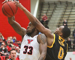 William D. Lewis The Vindicator YSU'sNazBohannon(33) and Milwaukee's Bryce Barnes(0) go for a rebound during 2-7-19 action at YSU.